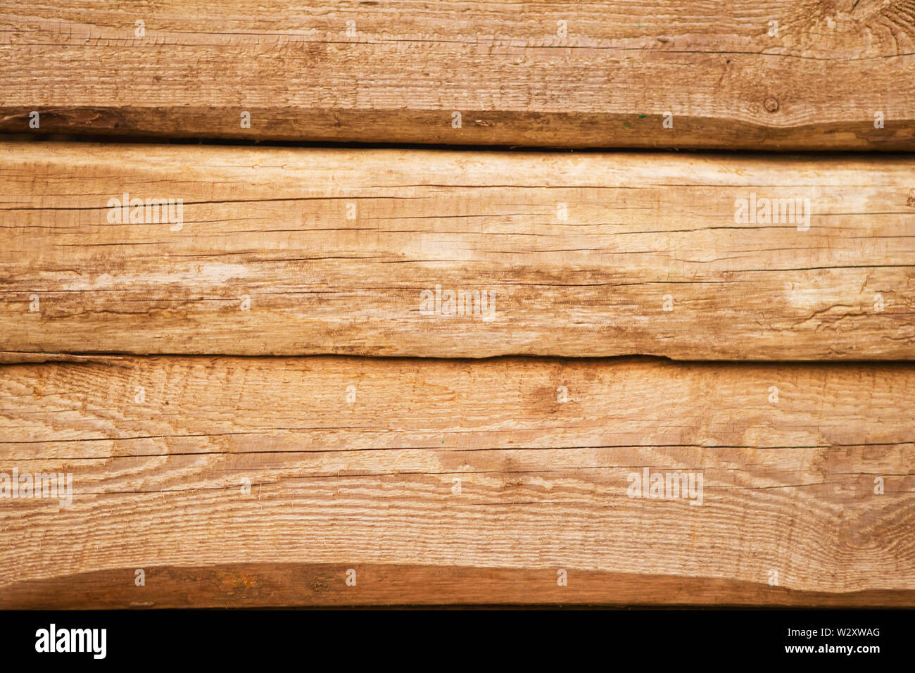 Old natural uncolored wooden wall surface. Background photo texture. - Stock Image