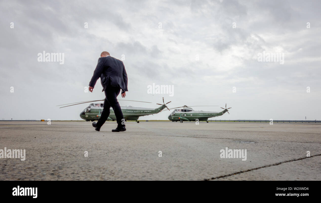 A Secret Service agent walks past the two Sikorsky SH-3 Sea