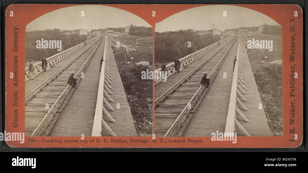 Looking across top of RR Bridge, Portage, NY, toward Depot, by Walker, L E, 1826-1916 2 - Stock Image