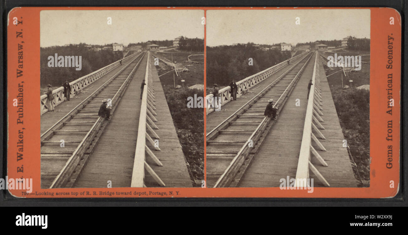 Looking across top of RR Bridge, Portage, NY, toward Depot, by Walker, L E, 1826-1916 - Stock Image