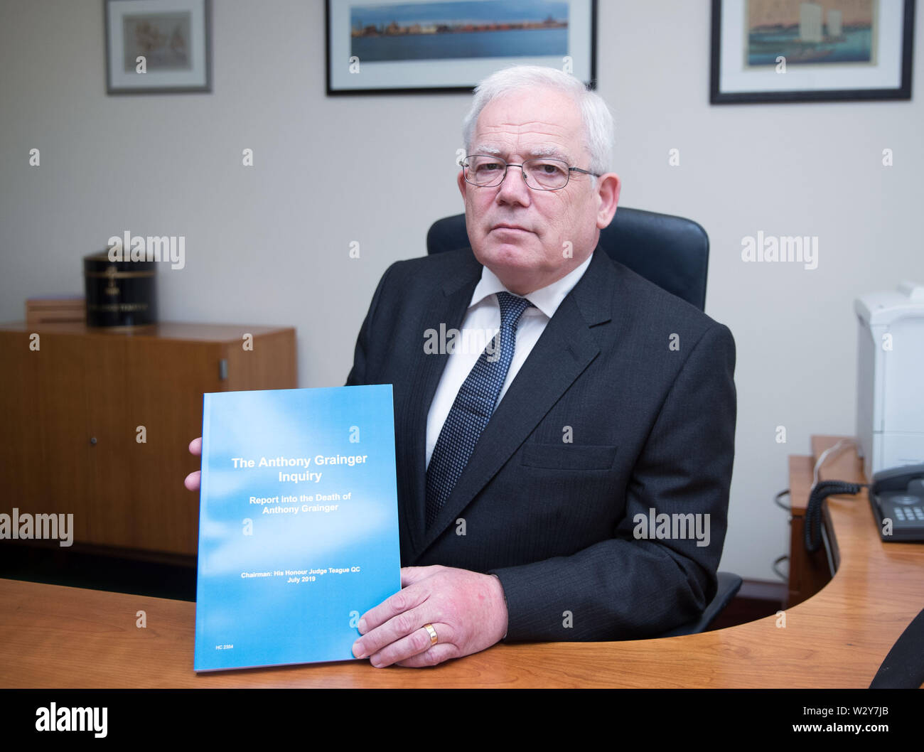 Chairman of the inquiry Judge Thomas Teague QC at Liverpool Crown Court with his report of a public inquiry into the death of Anthony Grainger ahead of its publication. Grainger, 36, from Bolton, was shot by a Greater Manchester Police firearms officer through the windscreen of a stolen Audi in a car park in Culcheth, Cheshire, on March 3 2012. - Stock Image