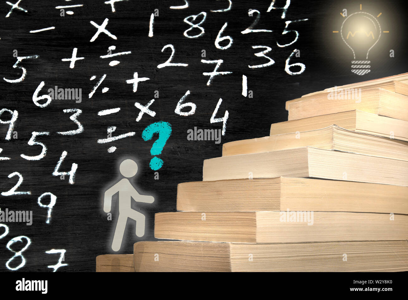 The man figure stepping books. reaching the target by studying. concept photo with numbers Stock Photo