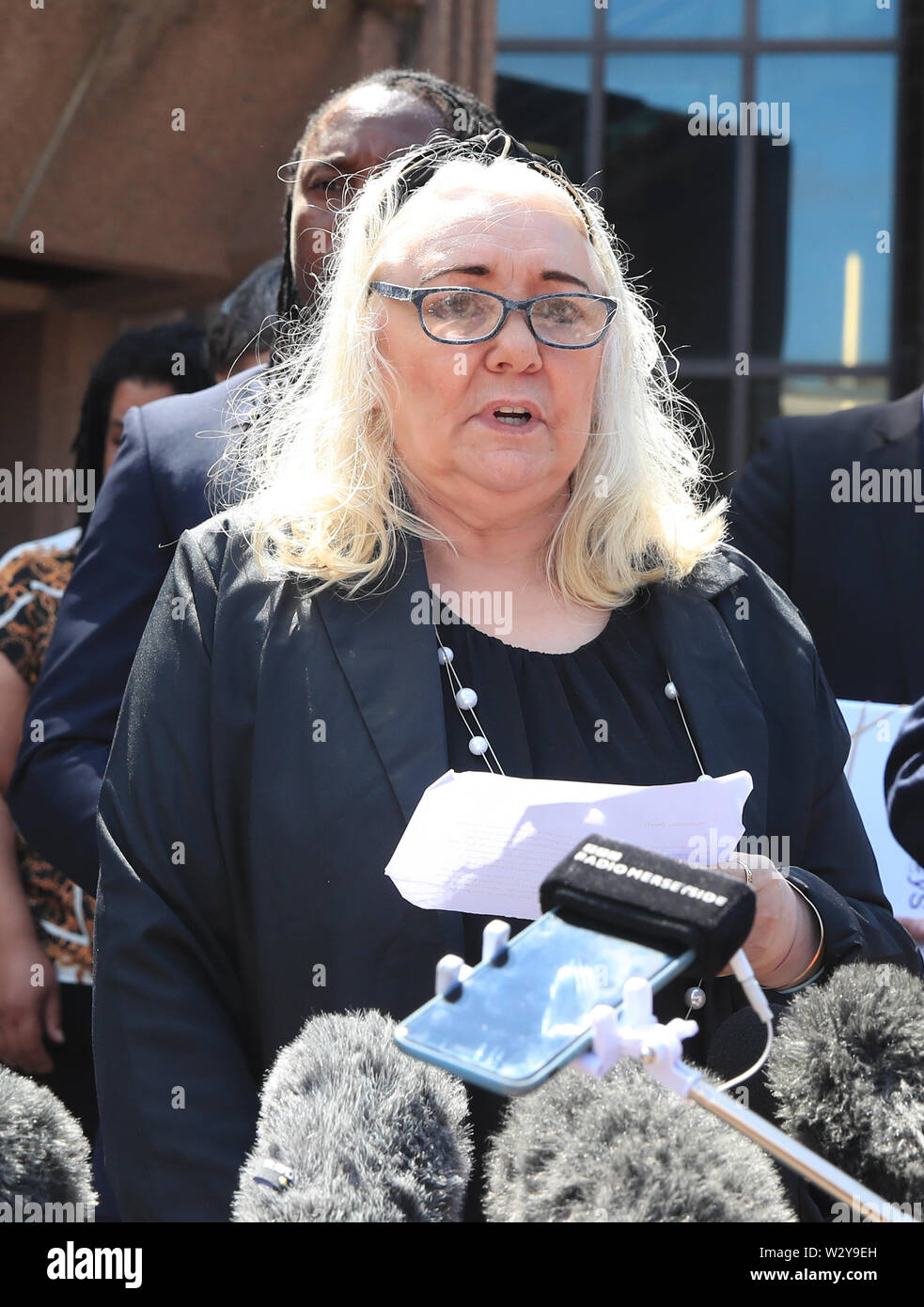 Anthony Grainger's mother Marina speaks to the media outside Liverpool Crown Court following the publication of the report of a public inquiry into the death of her son. Grainger, 36, from Bolton, was shot by a Greater Manchester Police firearms officer through the windscreen of a stolen Audi in a car park in Culcheth, Cheshire, on March 3 2012. - Stock Image
