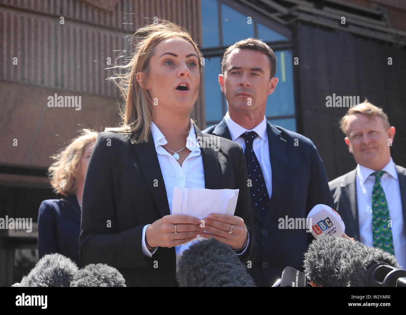 Anthony Grainger's partner Gail Hadfield Grainger speaks to the media outside Liverpool Crown Court following the publication of the report of a public inquiry into the death of the 36 year old. Grainger from Bolton, was shot by a Greater Manchester Police firearms officer through the windscreen of a stolen Audi in a car park in Culcheth, Cheshire, on March 3 2012. - Stock Image