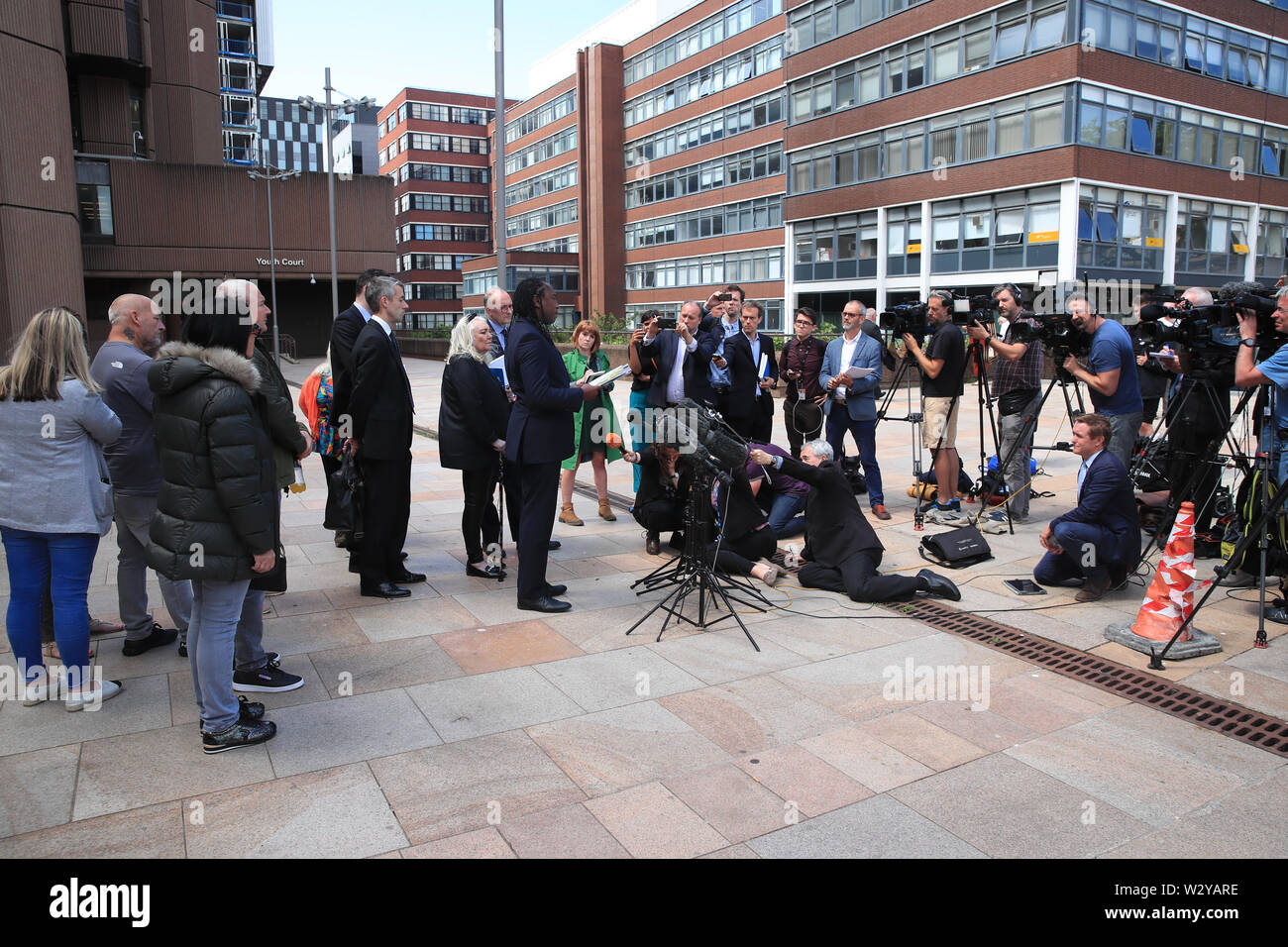Anthony Grainger's family lawyer Leslie Thomas QC speaks to the media outside Liverpool Crown Court following the publication of the report of a public inquiry into the death of the 36 year old. Grainger from Bolton, was shot by a Greater Manchester Police firearms officer through the windscreen of a stolen Audi in a car park in Culcheth, Cheshire, on March 3 2012. - Stock Image