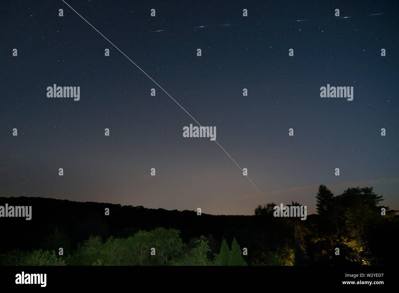 Iridium Flare, ISS, unknown Satellite, Natural park Muenden, Lower Saxony, Germany Stock Photo