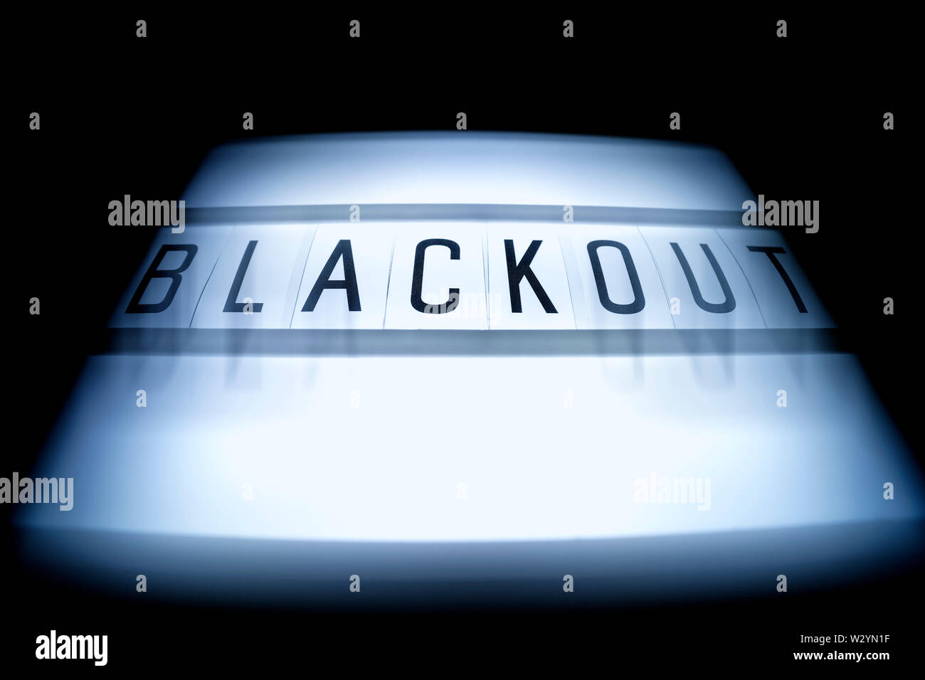 The word blackout on an illuminated panel, power failure - Stock Image