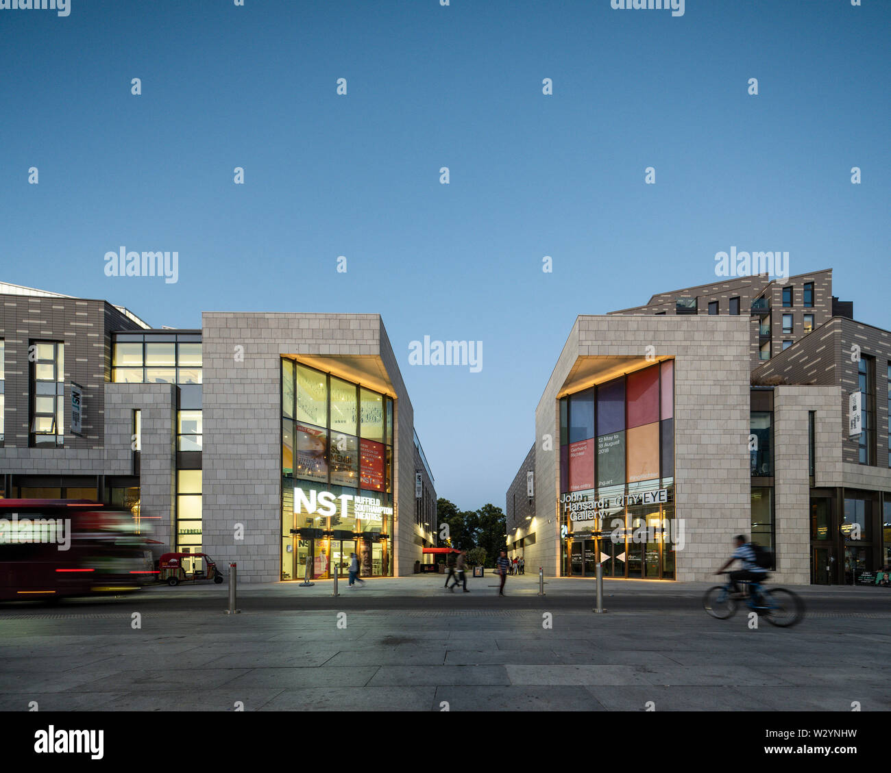 Dusk view across Guildhall Square with pedestrian route 'Guildhall Place'. Studio 144 - Southampton's Art Complex, Southampton, United Kingdom. Archit - Stock Image