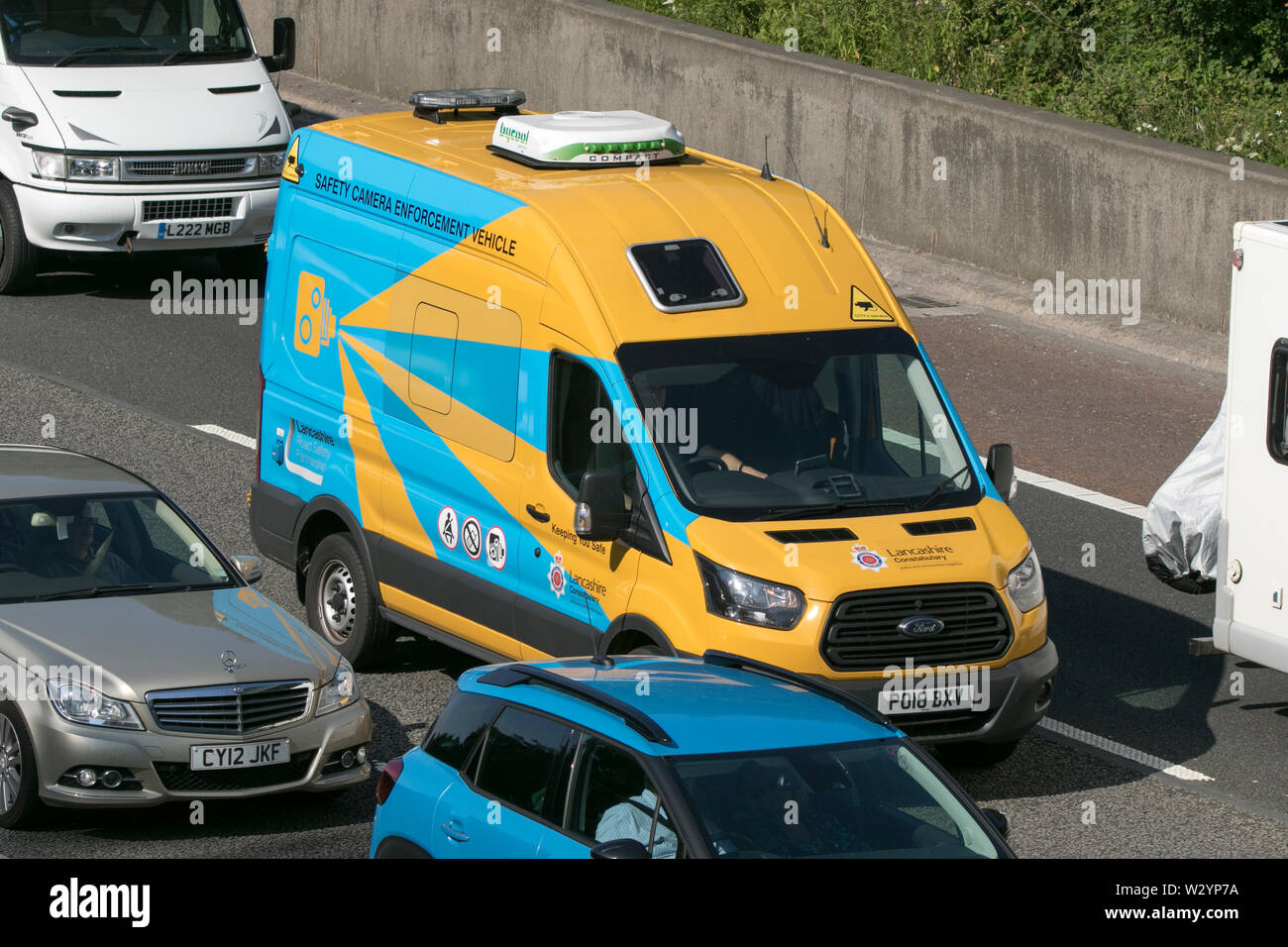 A Lancashire police speed enforcement camera van traveling in heavy traffic jam on the M6 motorway near Lancaster Stock Photo
