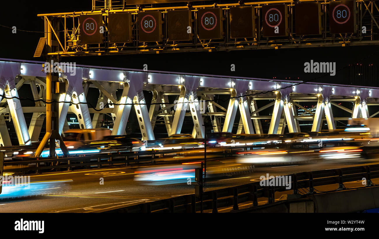 night traffic on the urban thoroughfare,overpass,   and road junction - Stock Image