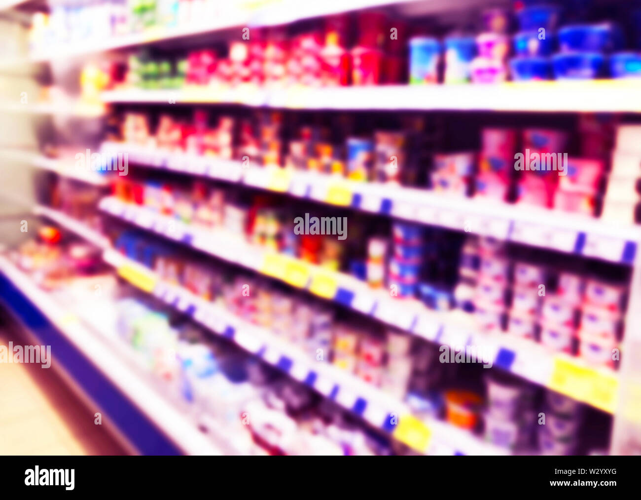 Abstract blurred supermarket store and refrigerators in department store. Interior shopping mall defocused background. Business food. Bokeh light back - Stock Image