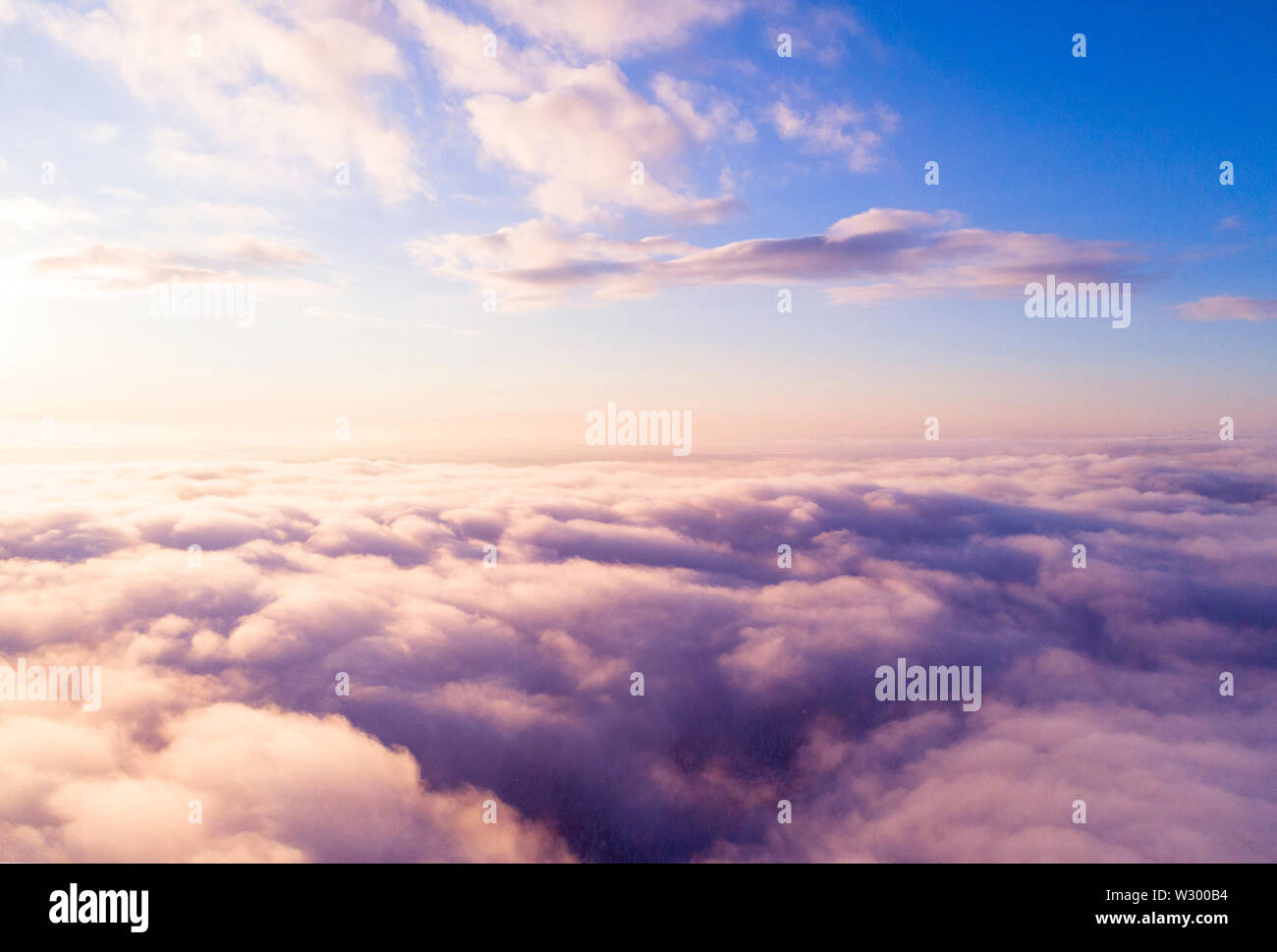 Aerial view White clouds in blue sky. Top view. View from drone. Aerial bird's eye view. Aerial top view cloudscape. Texture of clouds. View from abov Stock Photo