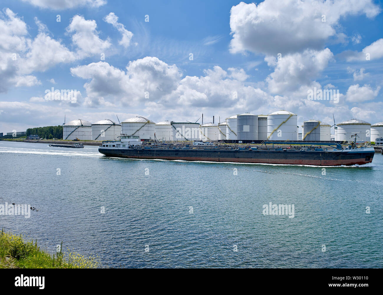 View on oil storage tanks in industrial area along the Caland canal near Rotterdam Stock Photo