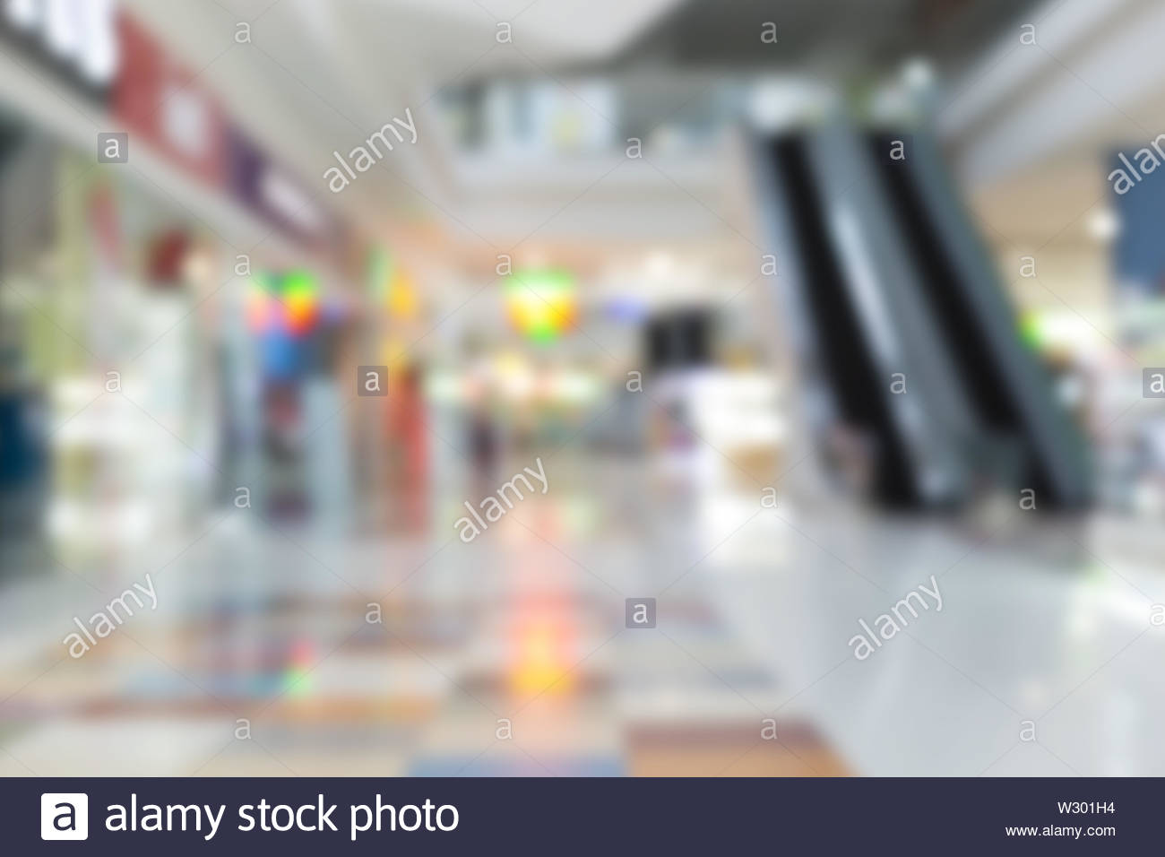 Blurred shopping mall and retail store interior background. - Stock Image
