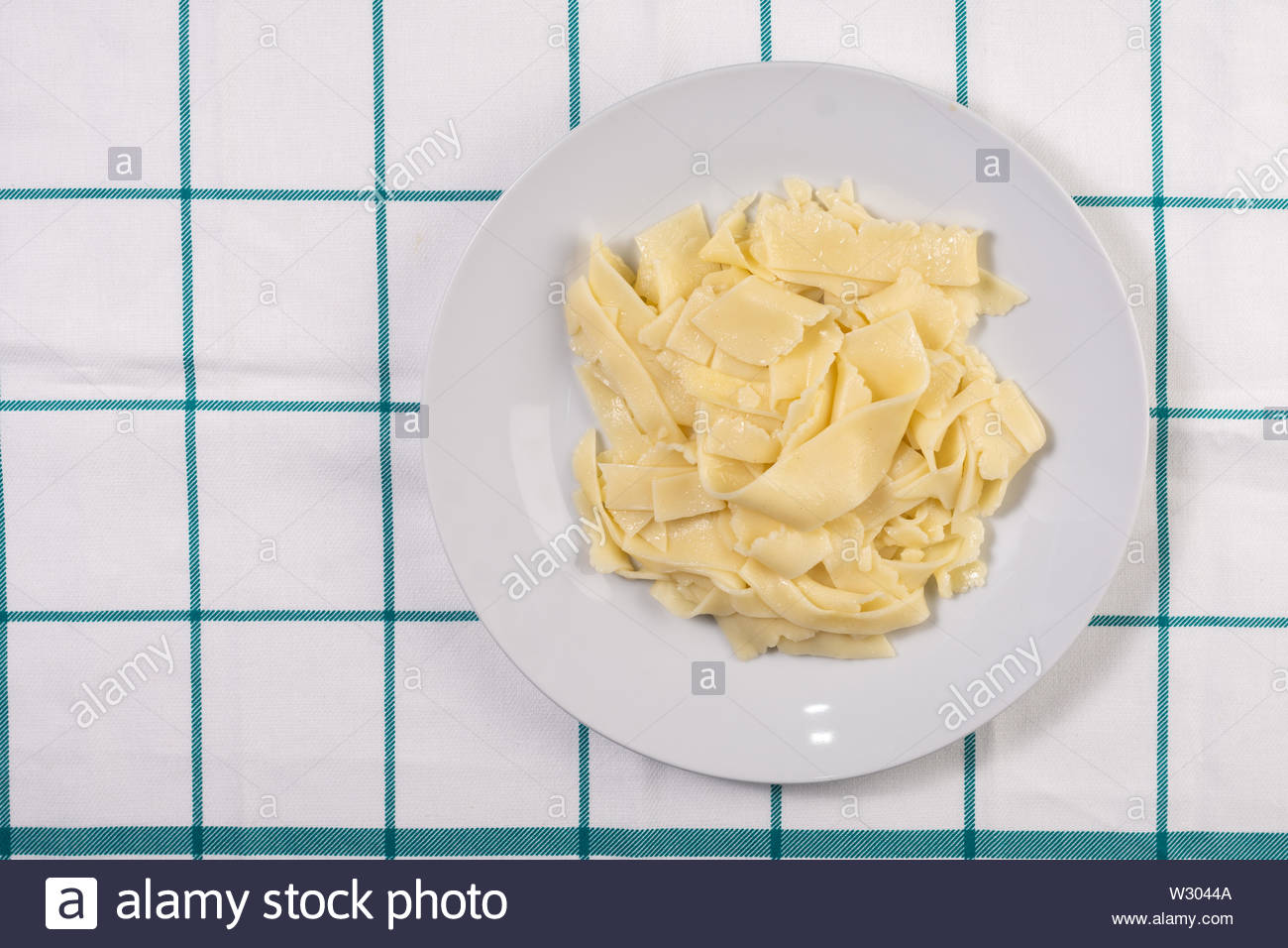 Mashed Potatoes served in the plate on the kitchen table - Stock Image