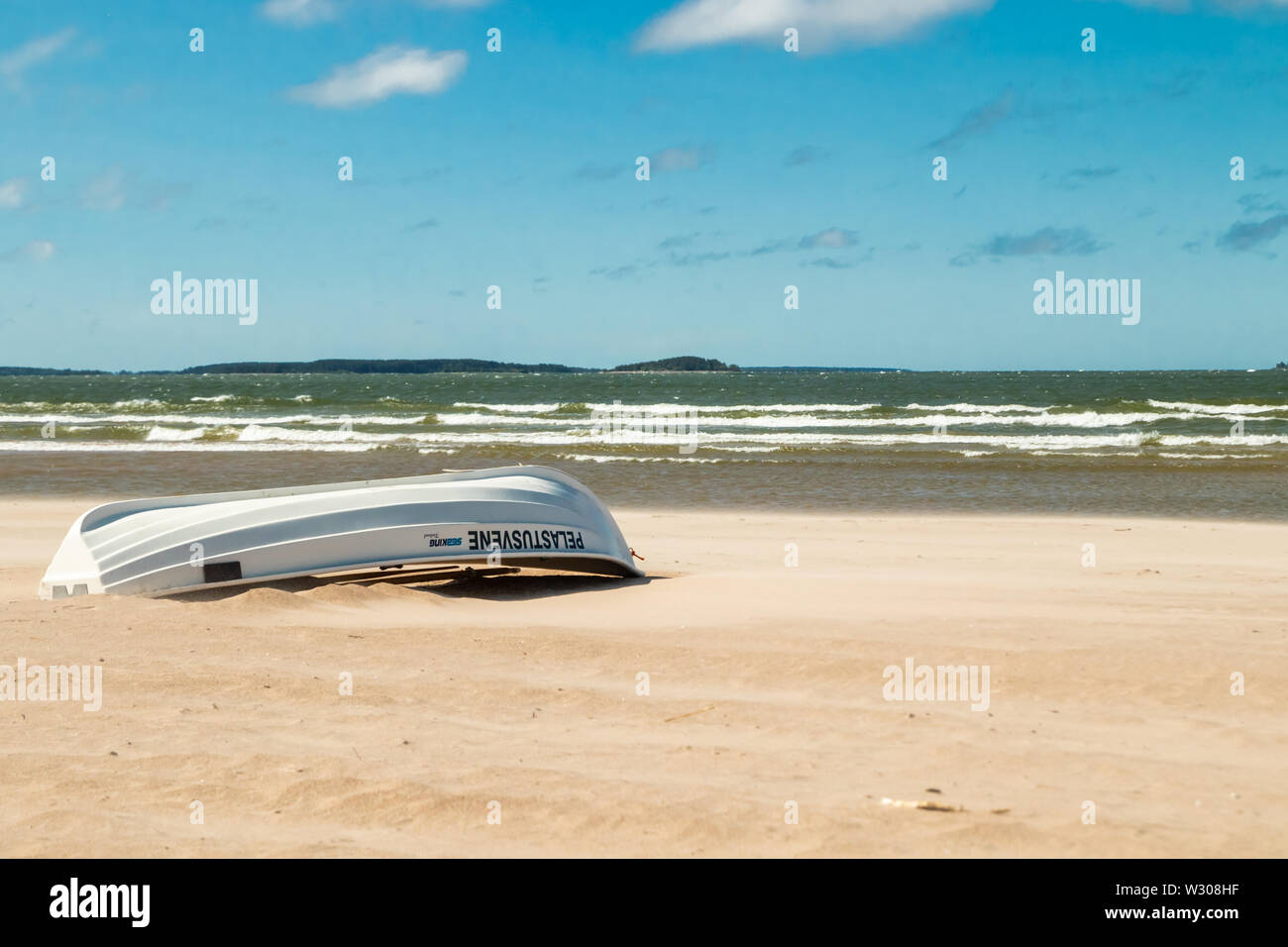 Pori, Finland - 27 June, 2019: Lifeboat on beautiful sandy beach Yyteri at summer, in Pori, Finland - Stock Image