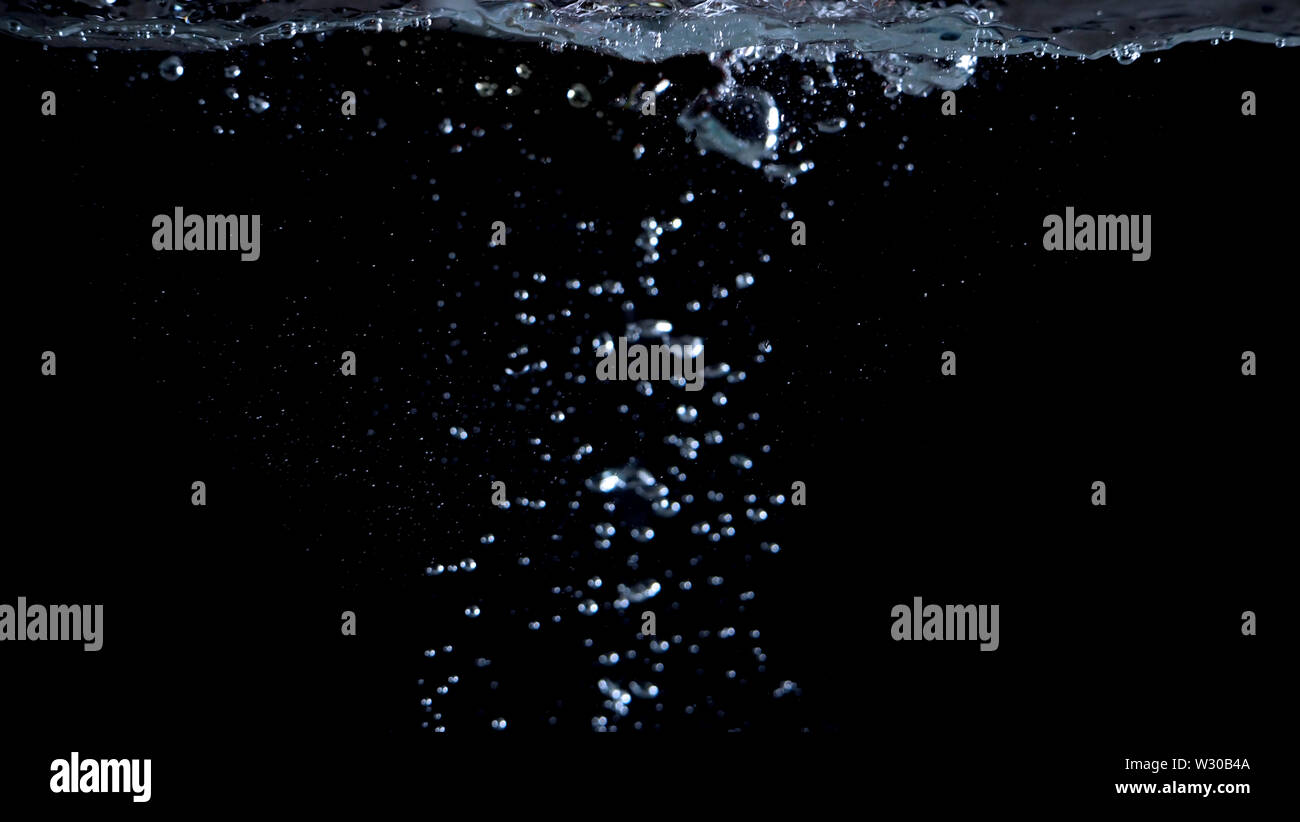 Blurry images of drinking water liquid bubbles or carbonate drink or oil shape or soda splashing and floating drop in black background for represent s - Stock Image