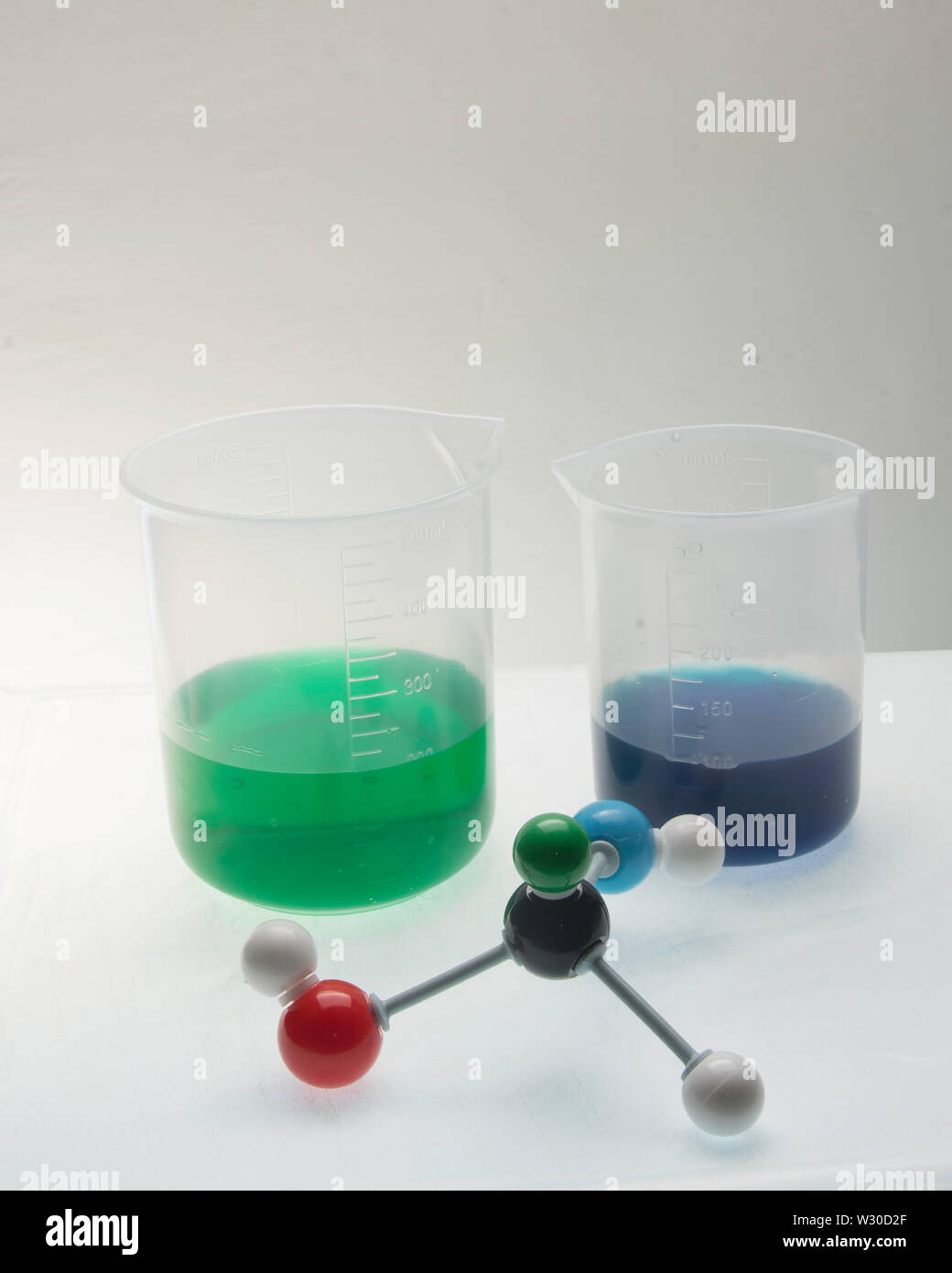 Molecule with various aspects of its compents and liquids in beakers. Stock Photo