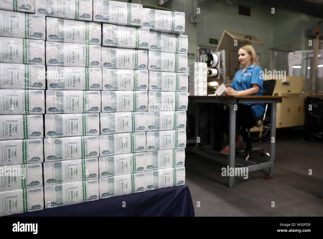 Moscow, Russia. 11th July, 2019. MOSCOW, RUSSIA - JULY 11, 2019: Packs of Russian 1,000-rouble banknotes at the Moscow Printing Factory owned by Goznak; the enterprise and its branch both celebrating their centenaries in 2019. Artyom Geodakyan/TASS Credit: ITAR-TASS News Agency/Alamy Live News - Stock Image