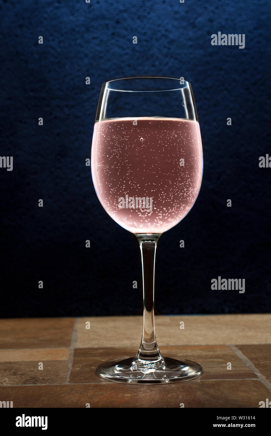 Sparkling Pink Wine On A Table With A Dark Background Low Key Light Photography Concept And Rim Light Concept Stock Photo Alamy