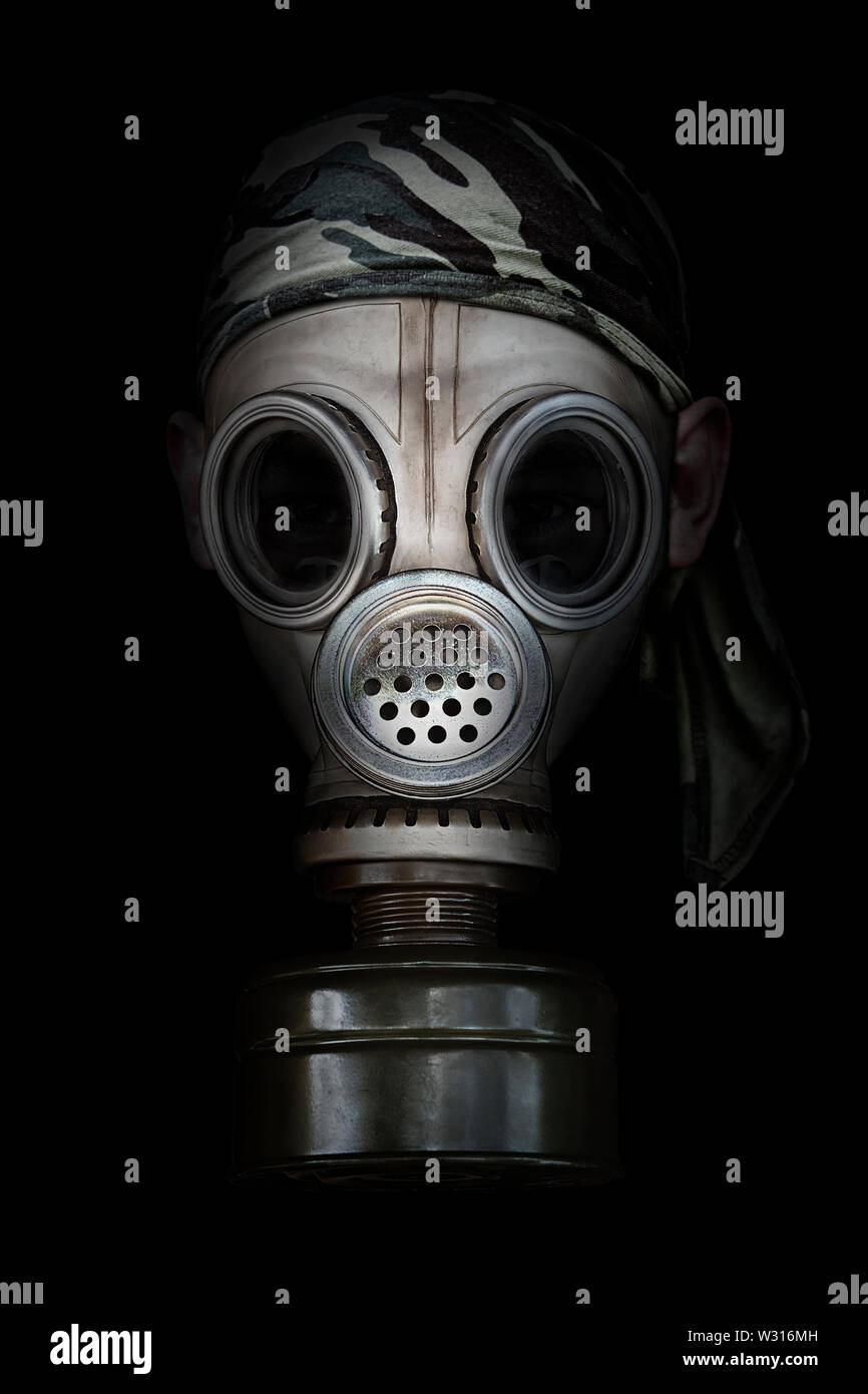 Old gas mask on a black background - Stock Image