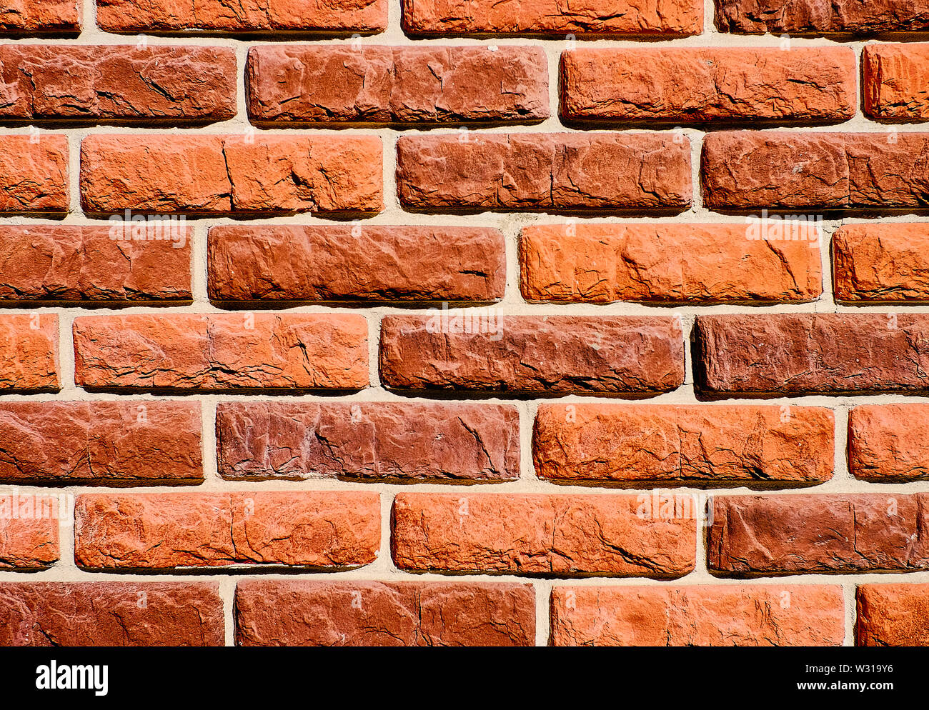 Background of red brick wall pattern texture. Great for graffiti inscriptions. Stock Photo
