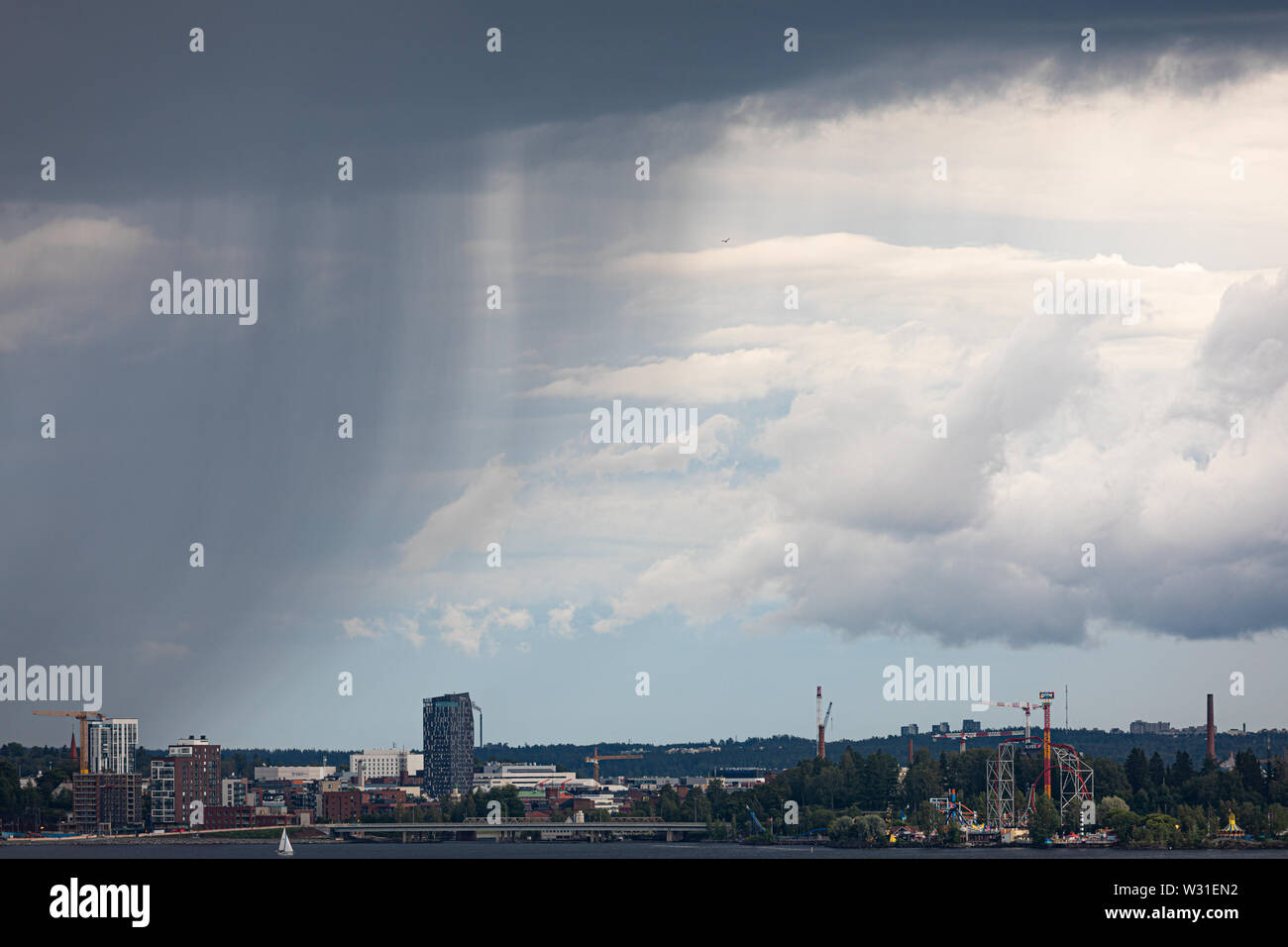 Summer day raining sky viewed from far - Stock Image