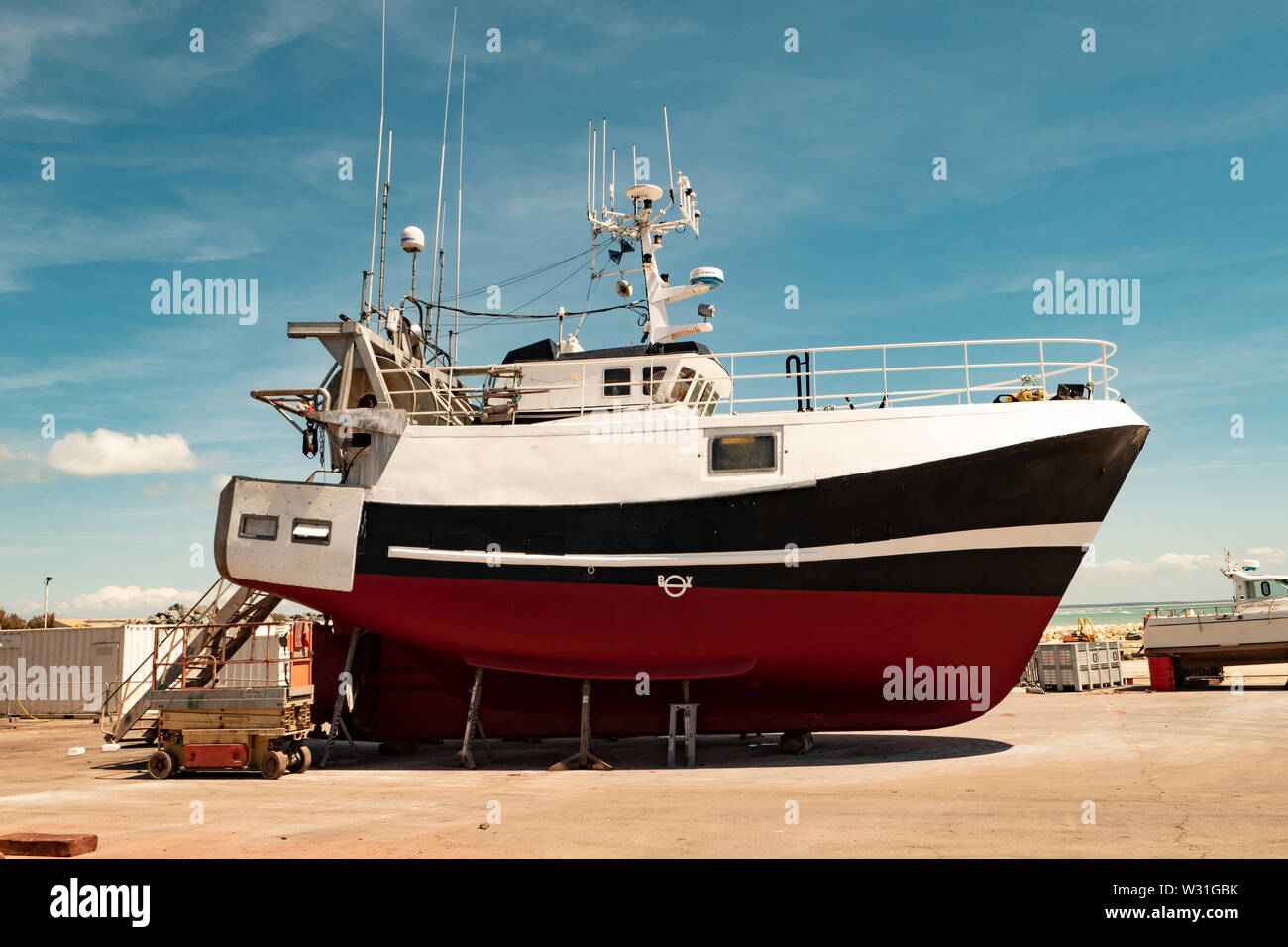 Hull of a boat for repair on the dry deck - Stock Image