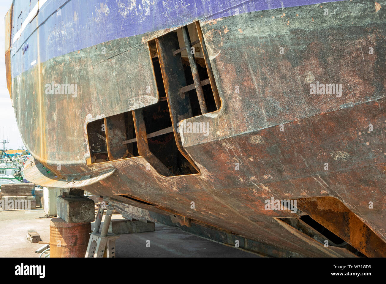 Ship is being repaired on its outer skin - Stock Image