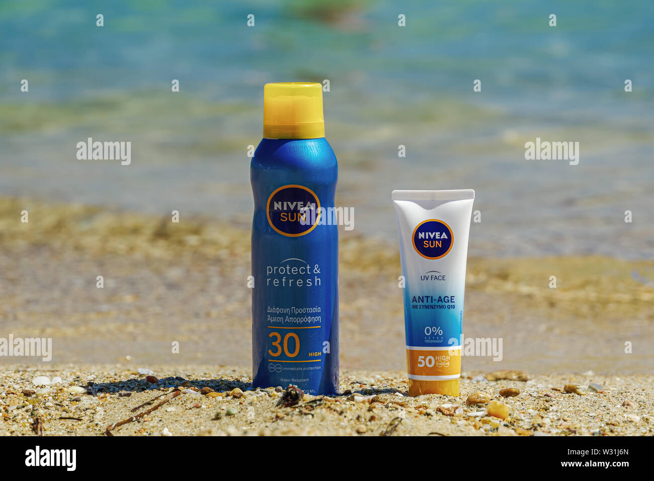 Nivea Sun body & face protection sunscreen creams on the beach with sea background. UV rays protect & refresh & anti-age lotions with SPF protection. - Stock Image