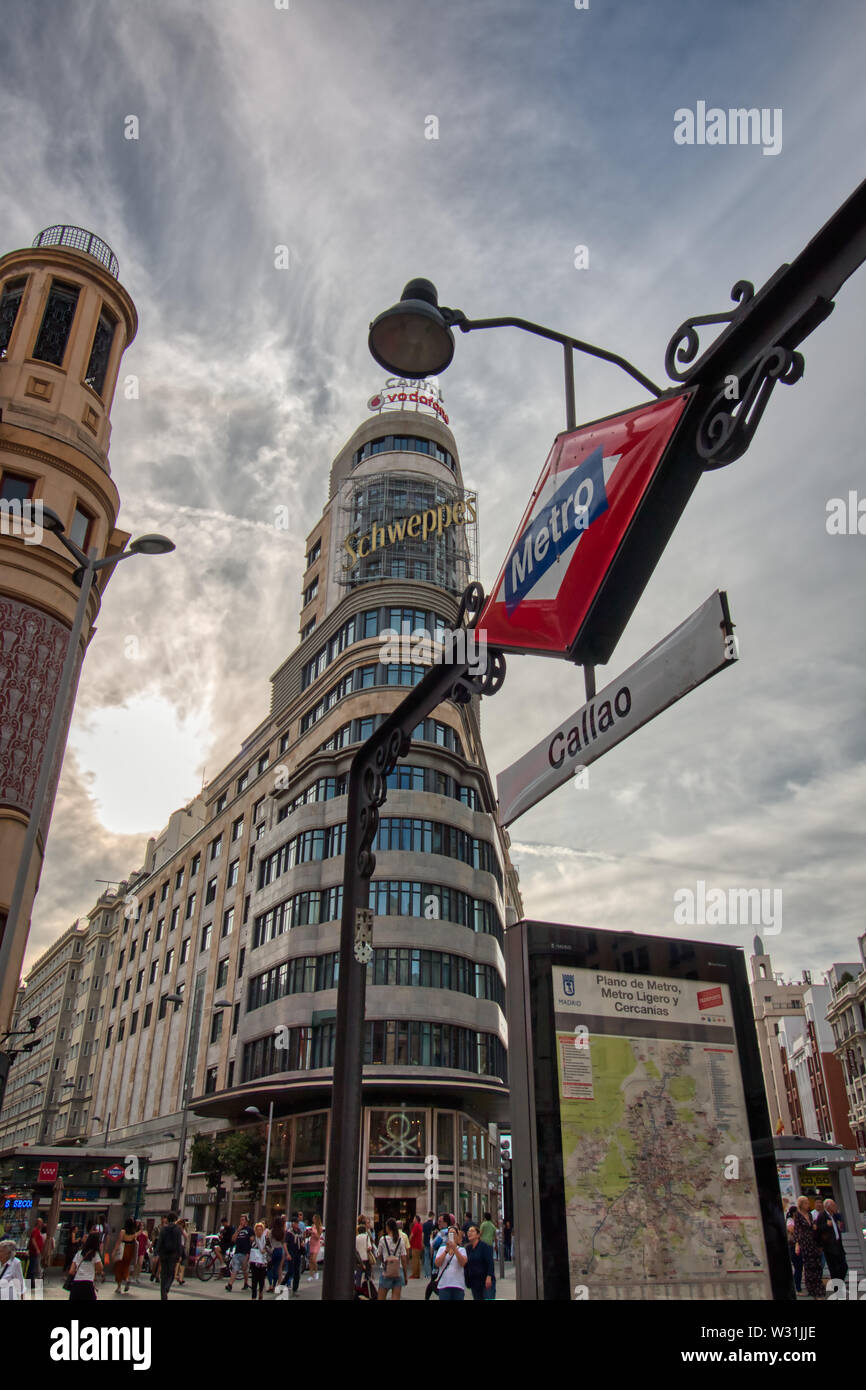 Madrid, Spain - June 20, 2019: Callao subway station, next to Gran Vía, with the Capitol building in the background, in the center of Madrid Stock Photo