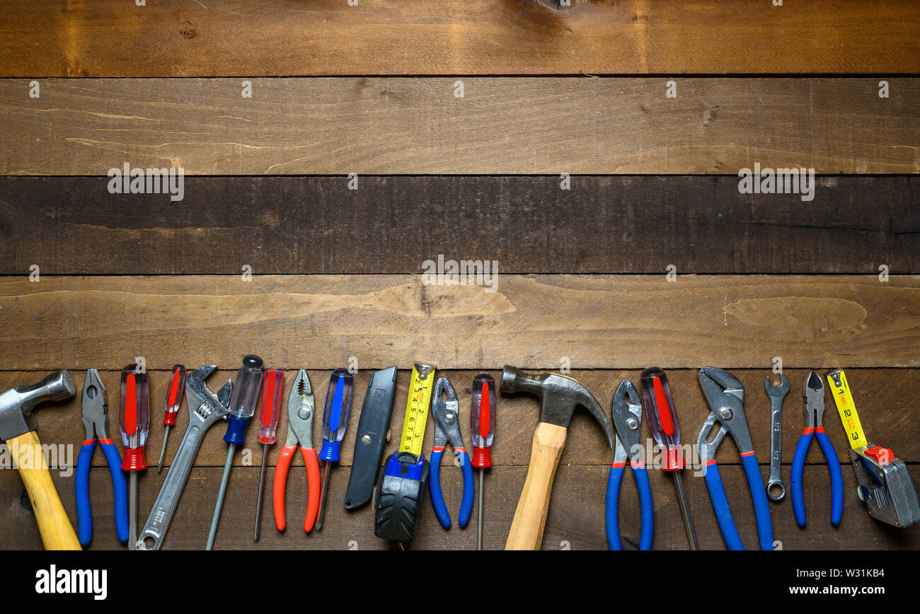Working tools on wooden background Stock Photo