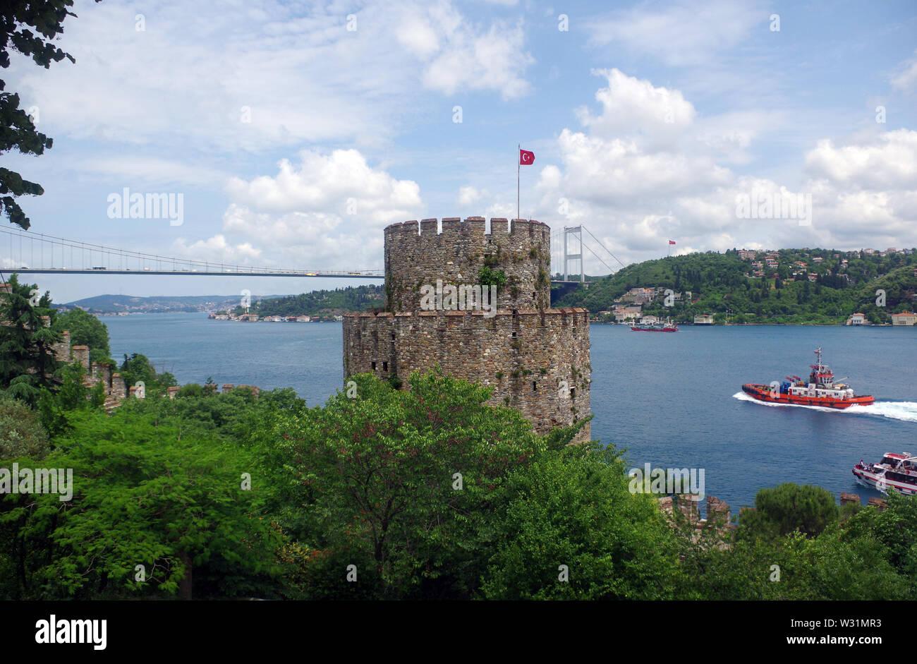 Rumelihisar Castle guarding the Bosphorus, with Fatih Sultan Mehmet Bridge visible in the background, Istanbul, Turkey Stock Photo