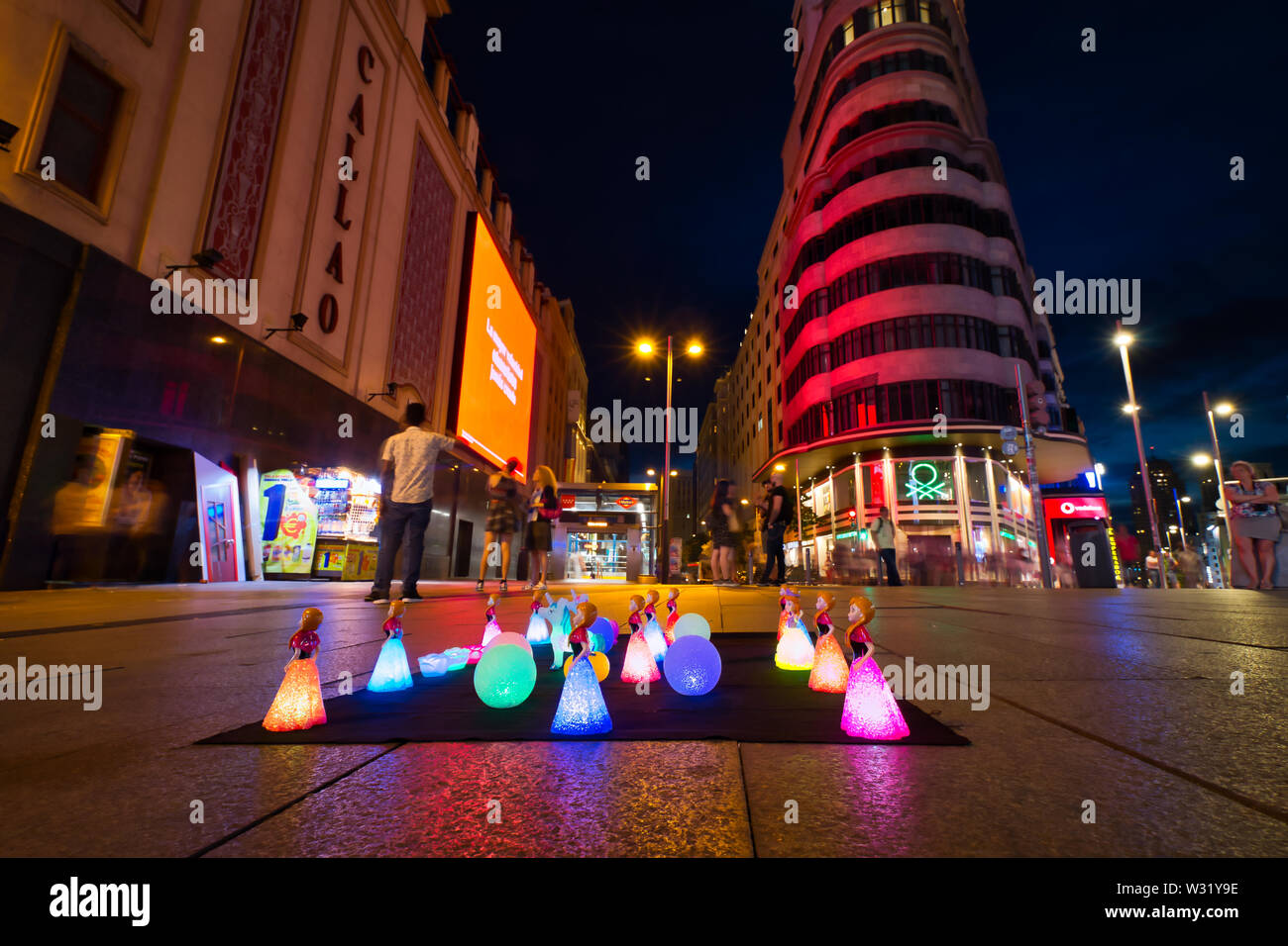 Madrid, Spain - June 20, 2019: Lamps lit in the shape of dolls and colored balls in the center of Madrid at night. Stock Photo