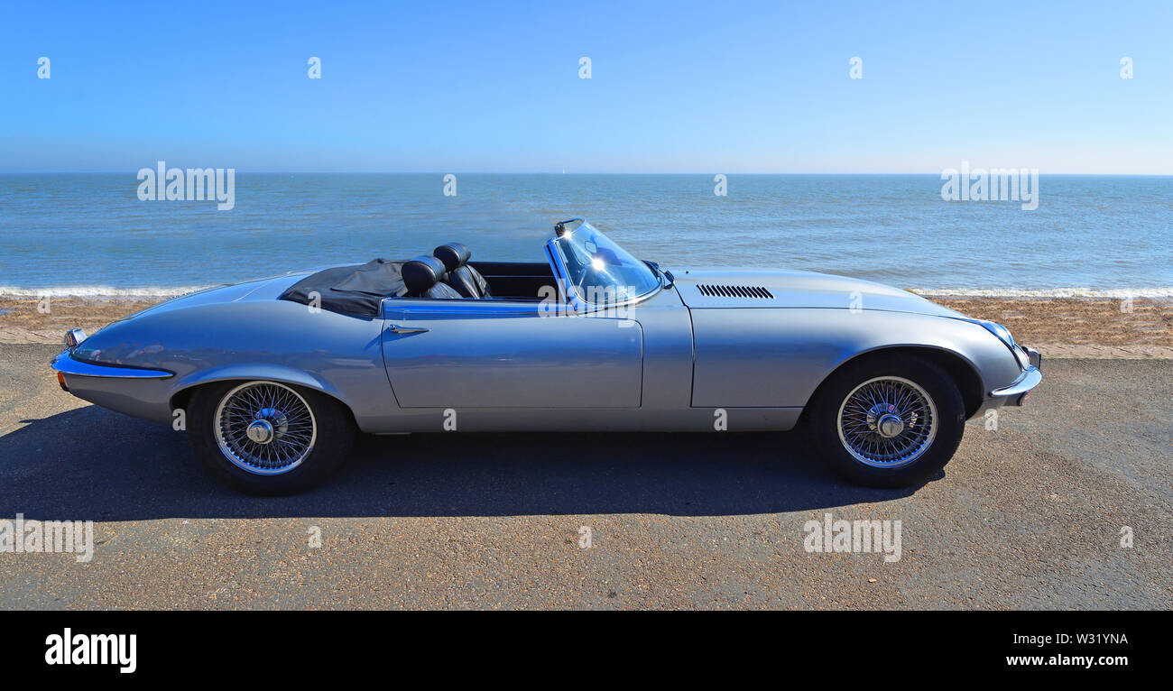 Classic Silver Jaguar  E  Type convertible  Motor Car Parked on Seafront Promenade. - Stock Image
