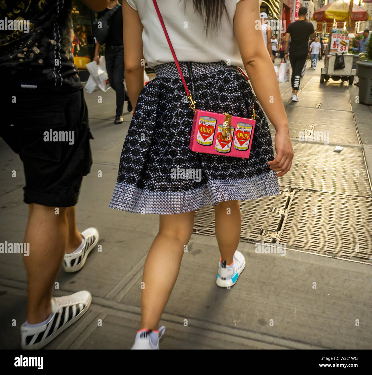 Asian tourists in New York with a handbag branded Dolce and Gabbana, on Tuesday, July 2, 2019. (© Richard B. Levine) - Stock Image