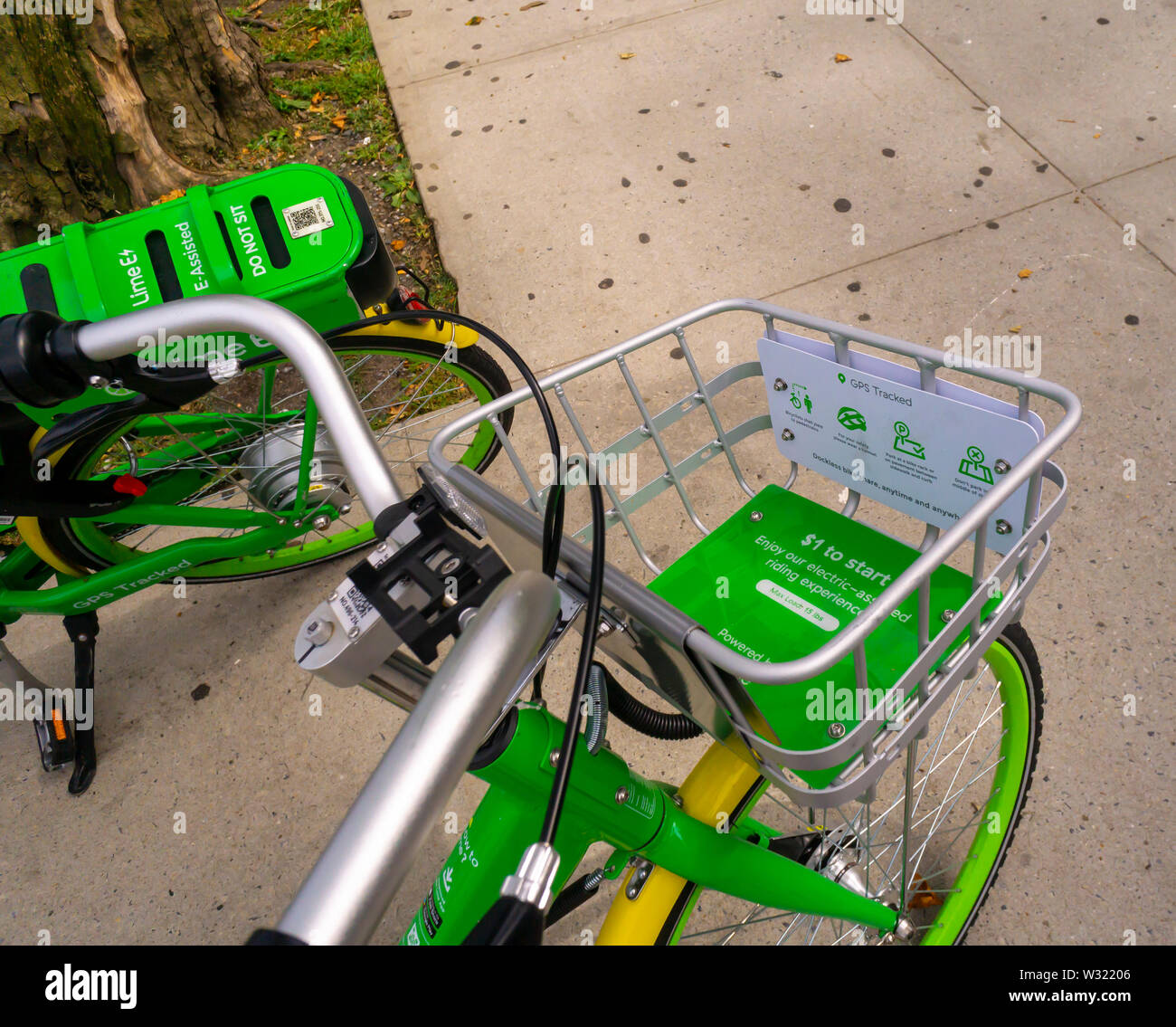 Lime-E brand e-bikes outside the Empire Outlets mall in Staten Island in New York on Saturday, July 6, 2019. (© Richard B. Levine) - Stock Image