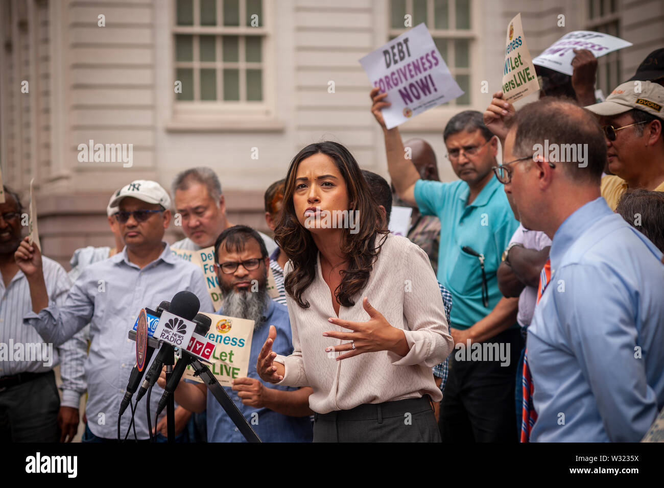 NYC Council Member Carolina Rivera speaks at a press conference with New York taxi drivers and their supporters on the steps of NY City Hall on Thursday, July 11, 2019  calling for debt forgiveness for their medallion loans. Medallion brokers allegedly took advantage of drivers who bought medallions at artificially inflated prices and ended up burdened with debt. A number of drivers have filed for bankruptcy or are considering it and there have been a few suicides amongst stressed drivers. (© Richard B. Levine) - Stock Image