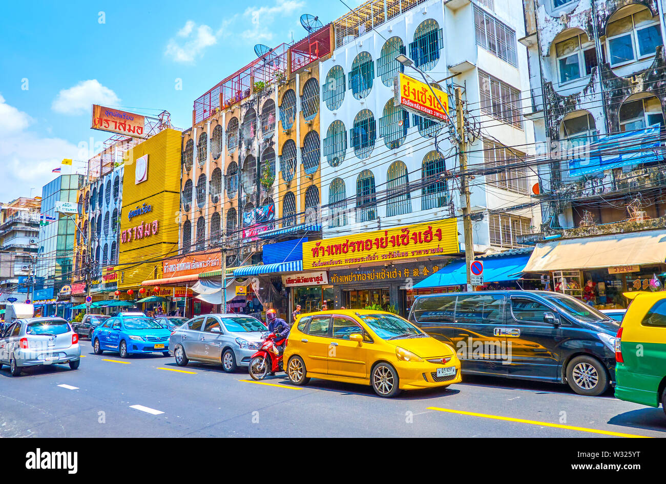 BANGKOK, THAILAND - APRIL 22, 2019: The small traffic jam in central tourist Banglampu district, on April 22 in Bangkok - Stock Image