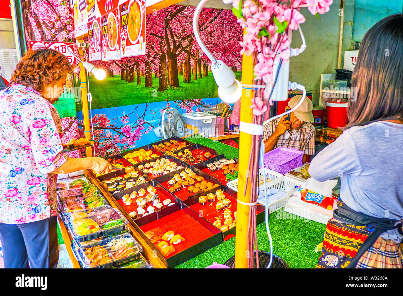 BANGKOK, THAILAND - APRIL 22, 2019: The small outdoor sushi bar with variety of rolls to take away, located in Charkrapong Road, Banglampoo, on April - Stock Image