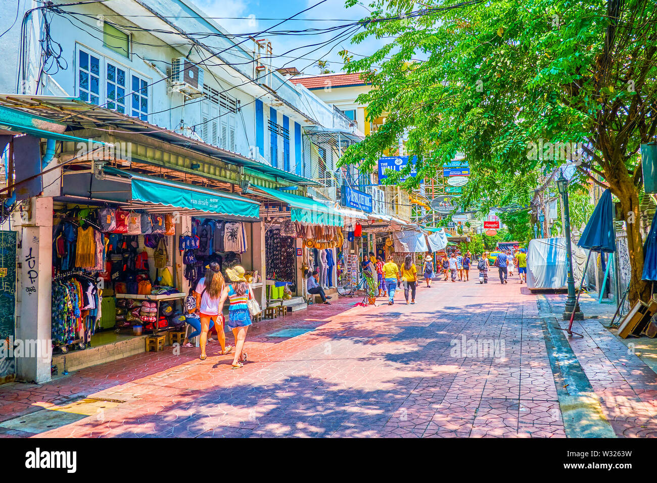 BANGKOK, THAILAND - APRIL 22, 2019: The small tourist clothing market offers variety of summer clothes, so needed in hot tropical climate, on April 22 - Stock Image