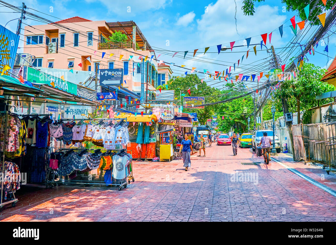 BANGKOK, THAILAND - APRIL 22, 2019: The popular Ram Buttri road with variey of tourist clothing shops and restaurants, on April 22 in Bangkok - Stock Image