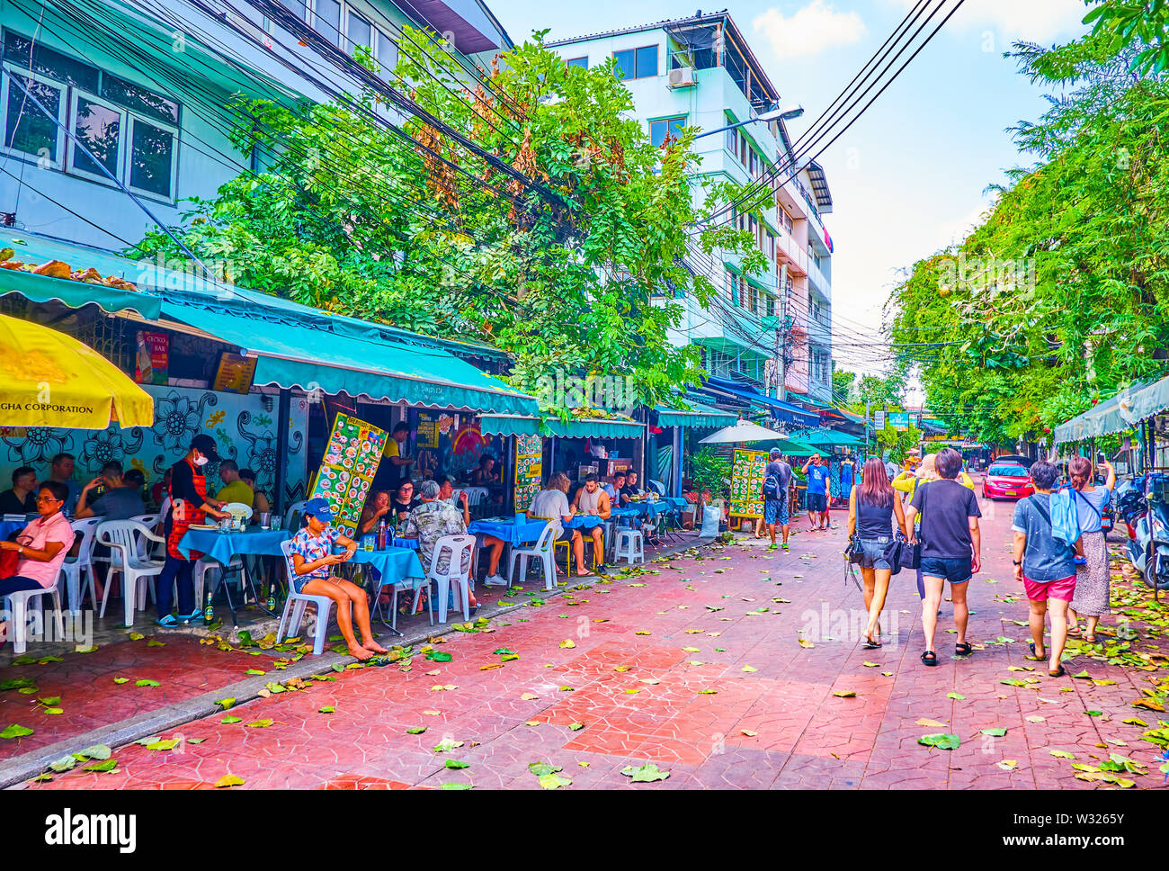 BANGKOK, THAILAND - APRIL 22, 2019: The cozy Ram Buttri street lacated in the center of the city and offers variety of hotels and restaurants with aff - Stock Image