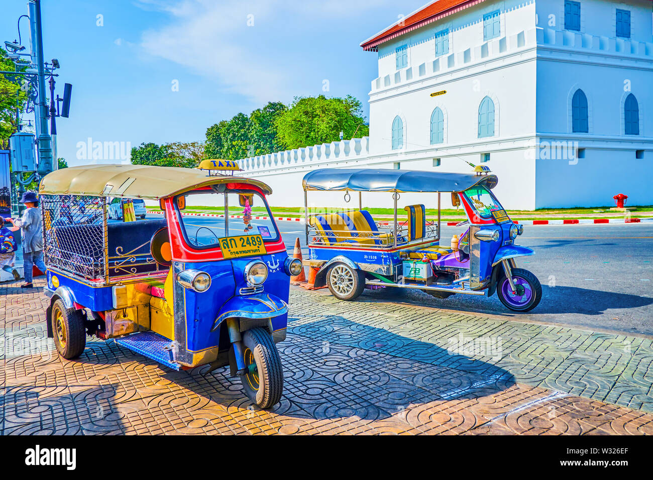 BANGKOK, THAILAND - APRIL 22, 2019: A tuk tuk ride along the busy streets of the city is one of the most exciting adventures in central district, on A - Stock Image