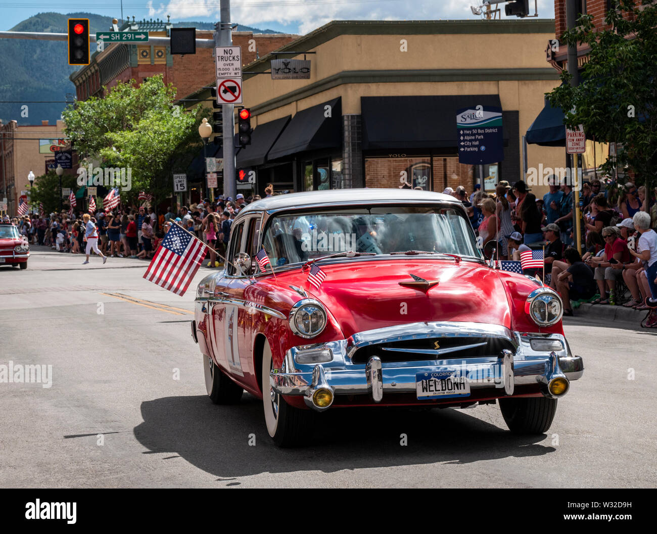 1955 Studebaker President classic car driving in the annual Fourth of July Parade; small mountain town of Salida; Colorado; USA Stock Photo