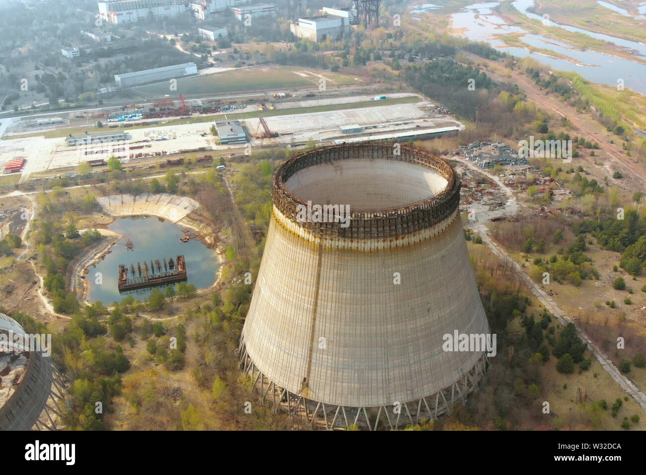 Drone flies over the cooling tower, top view - Stock Image