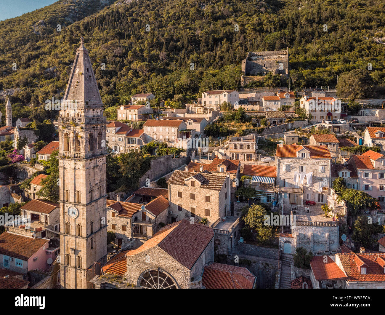 Kotor, Montenegro. Bay of Kotor bay is one of the most beautiful places on Adriatic Sea, it boasts the preserved Venetian fortress, old tiny villages, - Stock Image