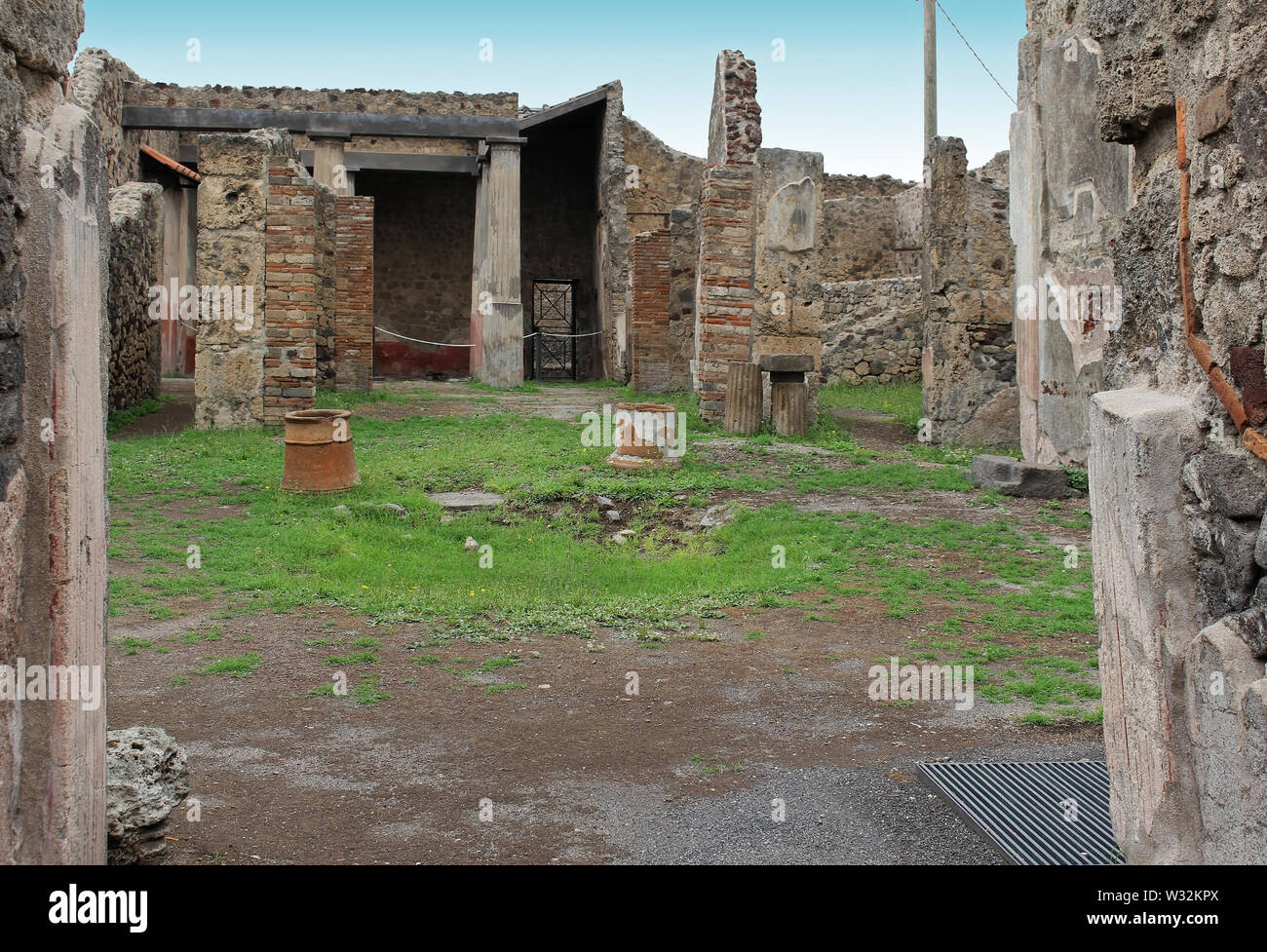 Ancient old ruins with damaged aged stone walls - Stock Image