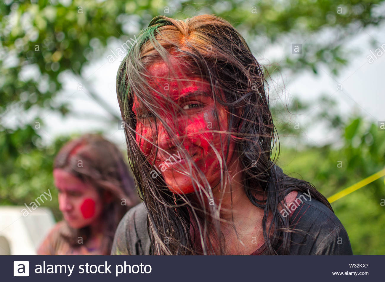 Young woman covered in powder paint - Stock Image