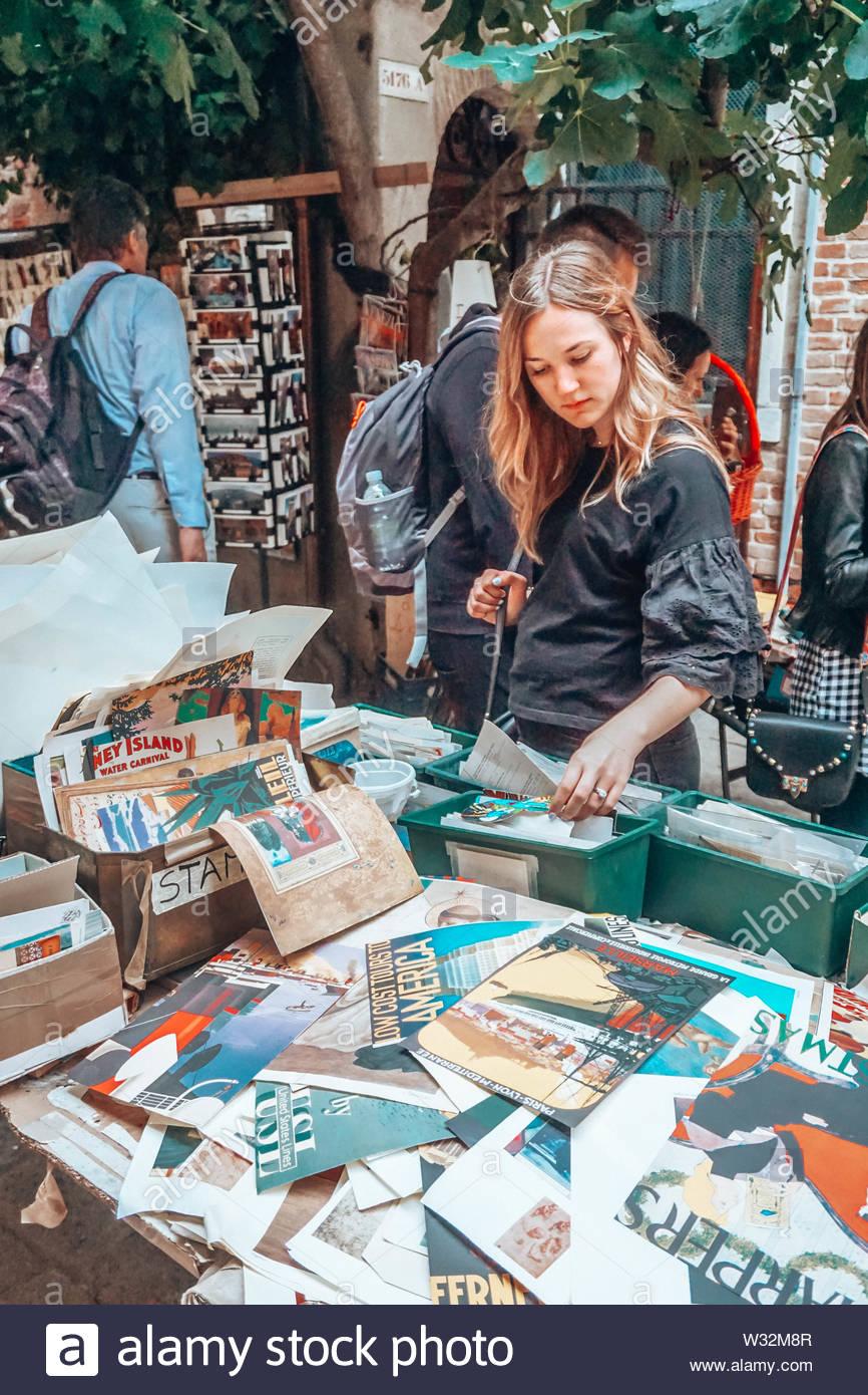 Woman at flea market - Stock Image